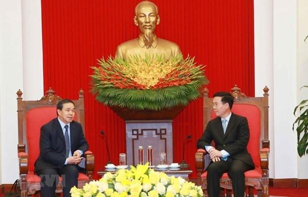 越南将同老挝一道维护和培育越老关系日益向前发展 hinh anh 1