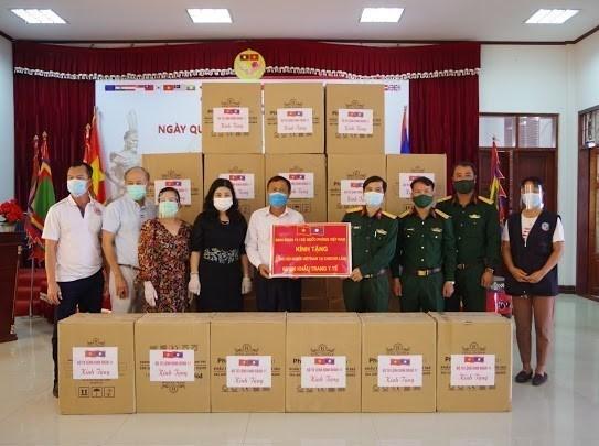 新冠肺炎疫情:旅居老挝越南人与老挝政府携手抗疫 hinh anh 1