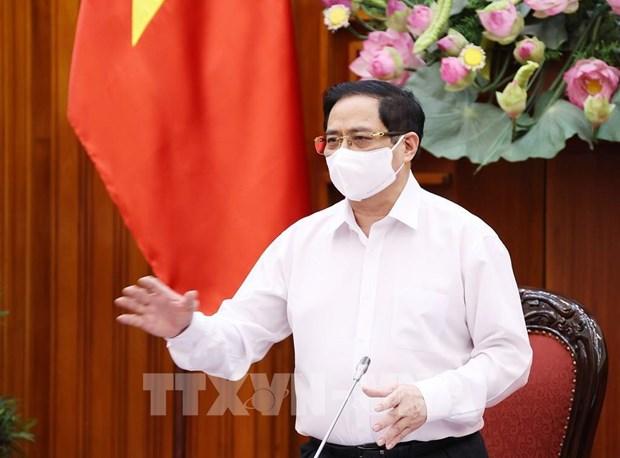 范明政总理:加紧争取尽快采购新冠疫苗 hinh anh 1