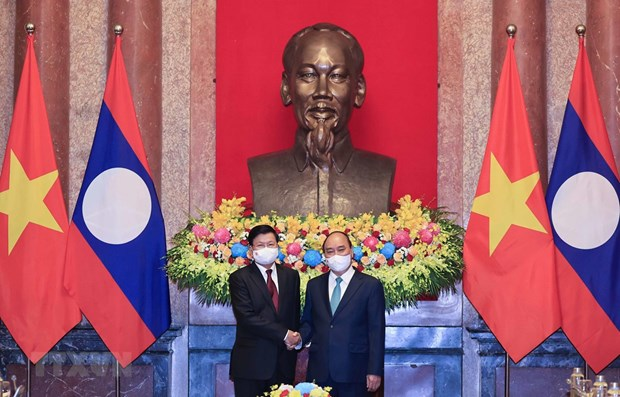 国家主席阮春福对老挝进行正式友好访问:彰显越南对老挝的鼎立和全方位支持 hinh anh 1