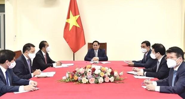 越南政府总理范明政与比利时总理德克鲁举行电话会谈 hinh anh 1