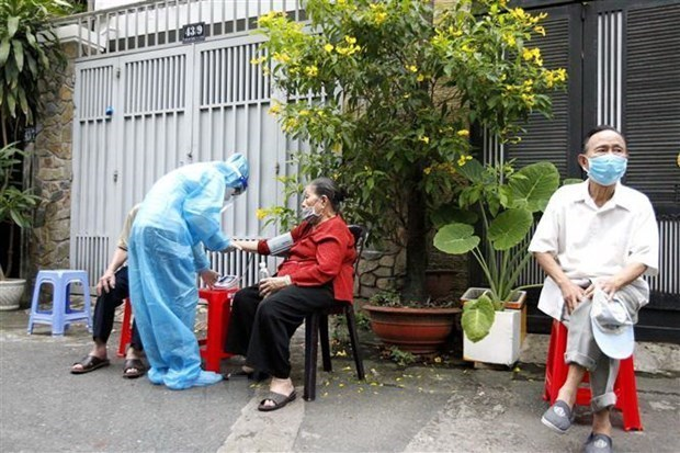 胡志明市力争完成超过720万18岁及以上人口新冠疫苗接种计划 hinh anh 1