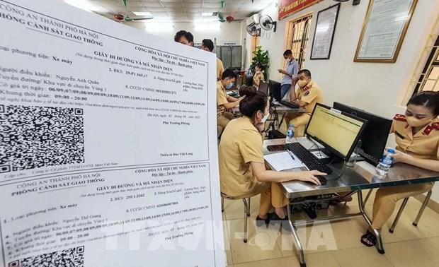从9月8日起河内出行必须持有新版的道路通行证 hinh anh 1