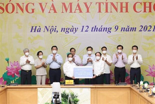 """政府总理范明政启动""""给儿童的网络和电脑""""项目 hinh anh 2"""
