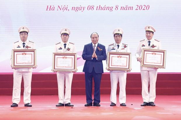 政府总理阮春福:公安力量应以为服务人民效果为竞赛目标 hinh anh 2