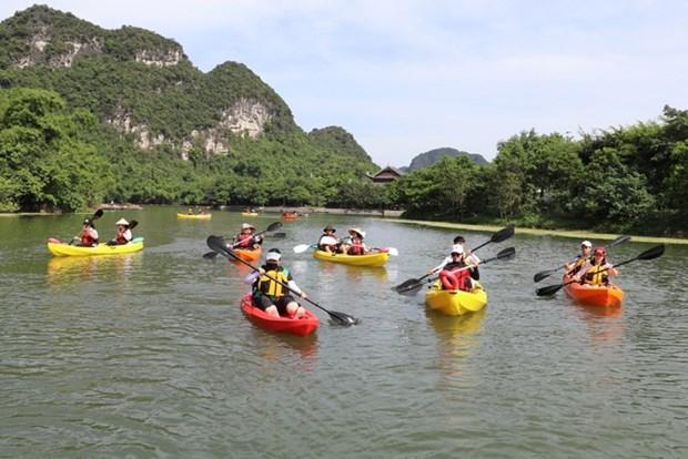 越南旅游:划皮划艇探索长安世界遗产之美 hinh anh 2