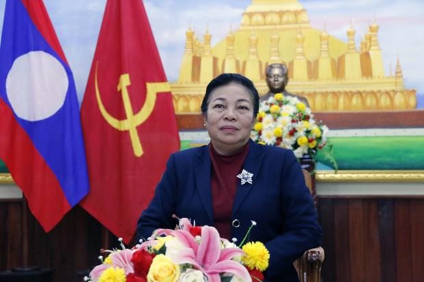 老挝人民革命党中央对外联络部部长:越南共产党领导越南取得举世瞩目的成就 hinh anh 1