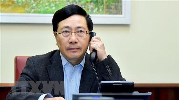 越南政府副总理兼外长范平明与古巴外长通电话 hinh anh 1