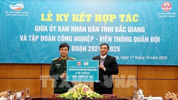 北江省与越南军队电信工业集团签署有关电子政务和智慧城市建设合作备忘录 hinh anh 2