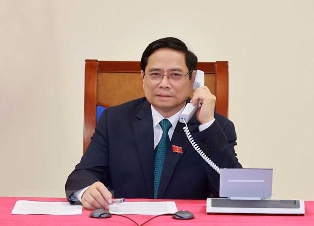 老挝总理与越南新任政府总理范明政通电话表示祝贺 hinh anh 1
