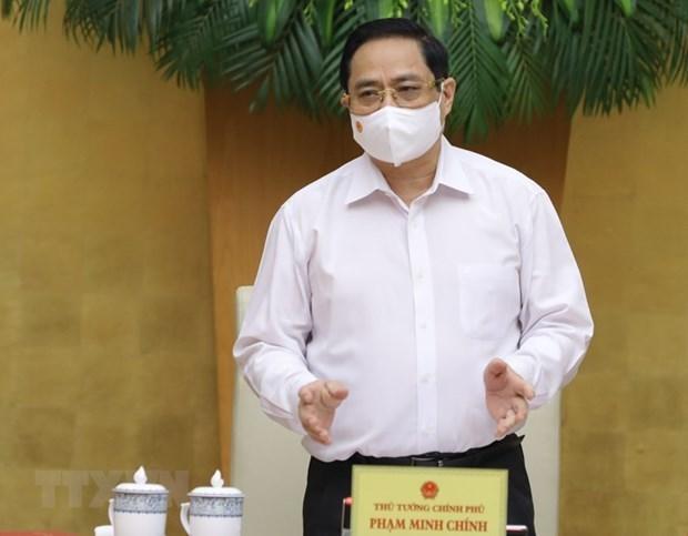 越南政府总理范明政主持第一次政府例行会议 hinh anh 1