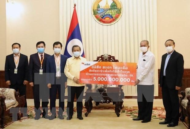 在老越南人社群同当地政府携手抗击新冠肺炎疫情 hinh anh 1