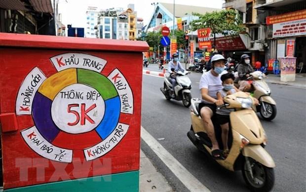 外国记者:越南面对疫情的袭击已迅速行动 精准防控 hinh anh 1