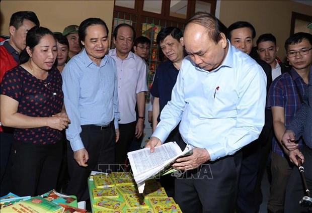 Thu tuong Chinh phu Nguyen Xuan Phuc: Tao dieu kien thuan loi cho cac hoat dong tai tro nhan dan vung lu hinh anh 2