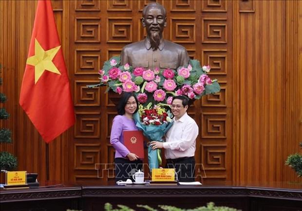 Thu tuong Pham Minh Chinh trao Quyet dinh bo nhiem ba Vu Viet Trang lam Tong Giam doc TTXVN hinh anh 2
