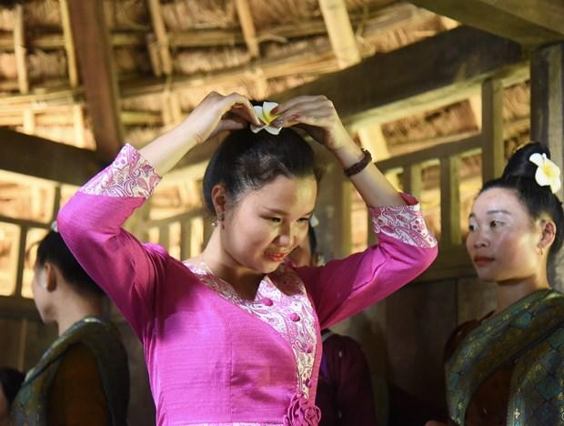 Tai hien nghi thuc Mung com moi cua dong bao dan toc Lao hinh anh 1