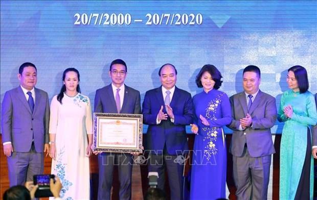 Thu tuong Chinh phu Nguyen Xuan Phuc danh cong ky niem 20 nam hoat dong thi truong chung khoan Viet Nam hinh anh 5