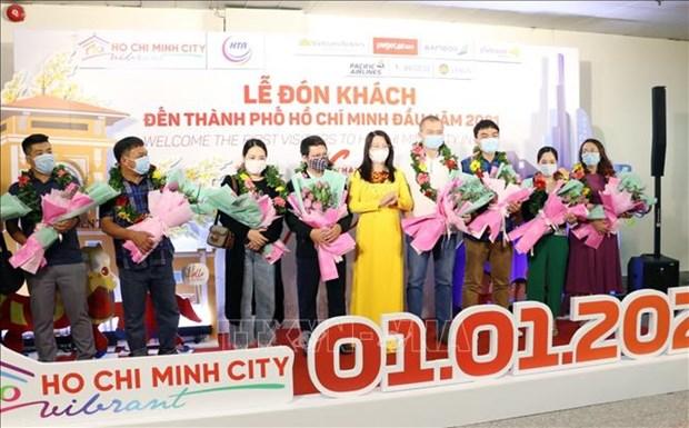 Du lich Viet Nam: Thanh pho Ho Chi Minh chao don nhung du khach dau tien nam 2021 hinh anh 5