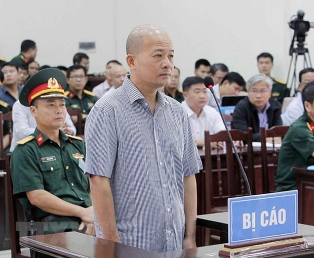 越南海军军种军事法院初审开庭 公开审理丁玉系和同案嫌犯 hinh anh 1