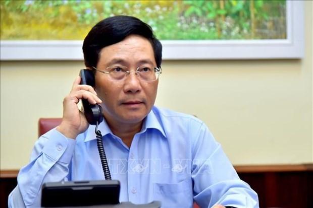 越南政府副总理兼外长范平明与意大利外交与国际合作部长迪马约通电话 hinh anh 1