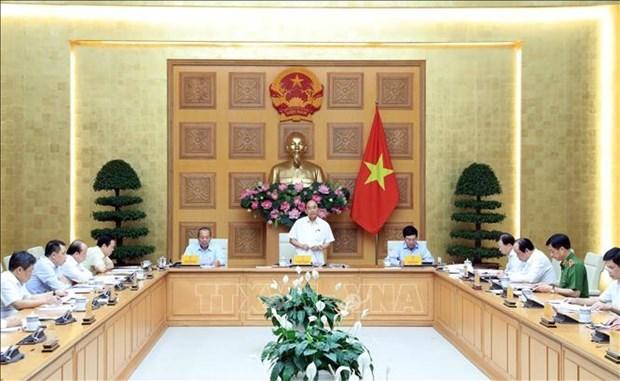 越南政府总理主持会议 为石油和航空企业化解困难 hinh anh 1