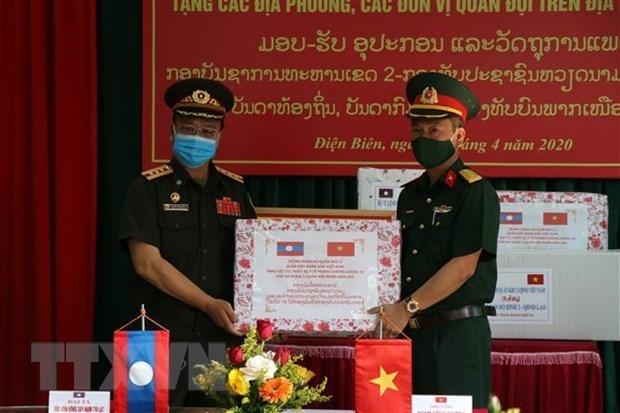 广义省向老挝占巴塞省提供防疫医疗物资援助 hinh anh 1