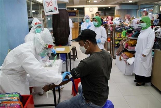 东南亚地区的疫情情况:老挝连续45天无新增新冠肺炎确诊病例 hinh anh 2