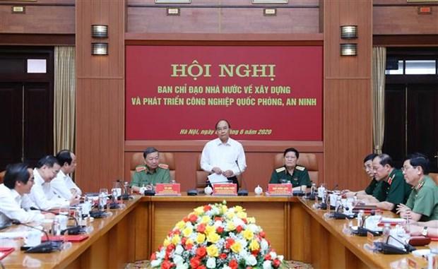 越南政府总理主持国家安全与国防工业建设与发展会议 hinh anh 1