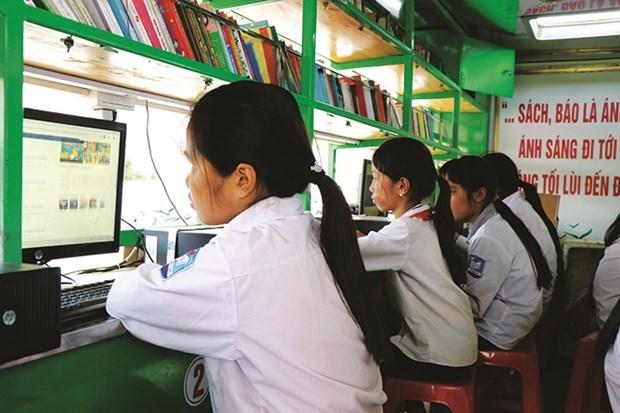 """""""流动图书车""""模式在边境地区开展阅读推广活动 hinh anh 1"""
