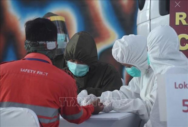 新冠肺炎疫情:新加坡将于6月19日全面恢复商业活动 hinh anh 2