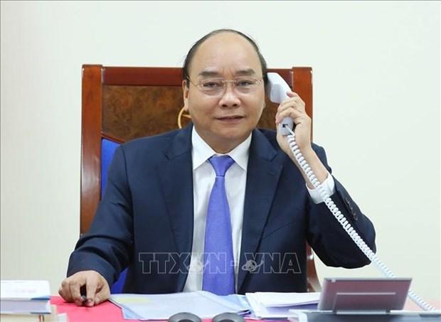 越南政府总理阮春福与马来西亚总理慕尤丁通电话 hinh anh 1