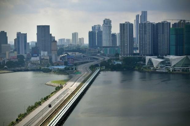 新加坡和马来西亚重新开放边境 hinh anh 1
