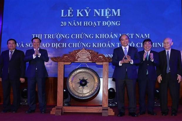 越南政府总理出席越南证券市场成立20周年纪念典礼 hinh anh 1