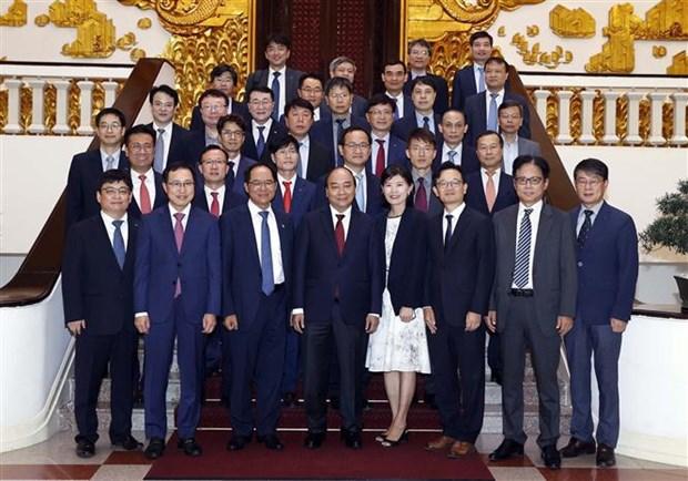 越南政府总理阮春福会见在越南投资兴业的韩国企业代表团 hinh anh 2