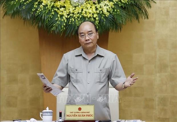 阮春福总理:坚决遏制第二波新冠疫情扩散 避免经济遭受创伤 hinh anh 1