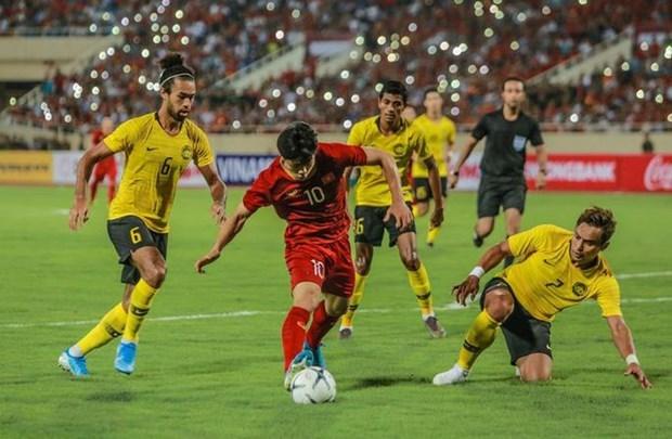 2022年世界杯亚洲区预选赛:10月13日越南队与马来西亚队一争高下 hinh anh 1
