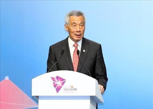 李显龙总理呼吁全国人民要保持坚韧不拔 应付严重的经济衰退 hinh anh 1