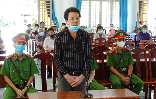 西宁省开庭审理一起组织他人非法入境越南案 涉案男子被判有期徒刑7年 hinh anh 1