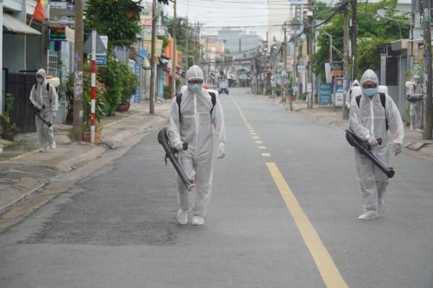 新冠肺炎疫情:从明日起高平省将对不戴口罩者罚款 同奈省解除一条街道封锁 hinh anh 2
