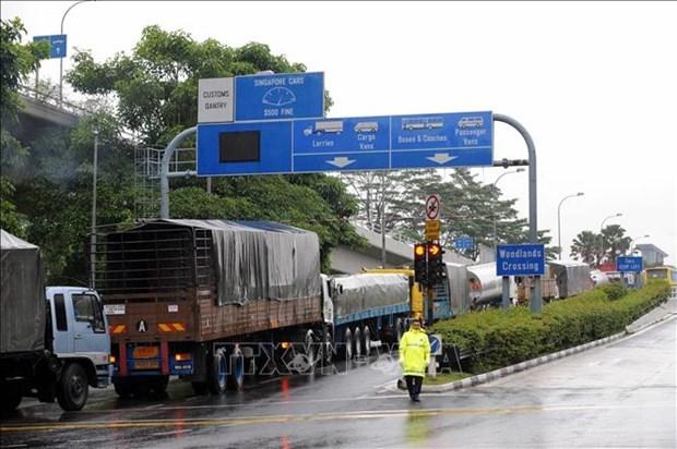马来西亚和新加坡正式开放两国边境 hinh anh 1