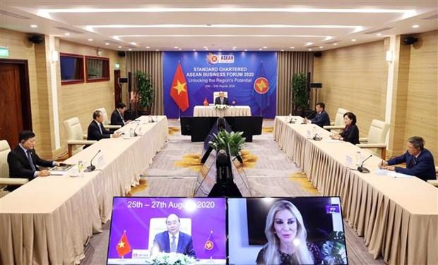越南政府总理阮春福出席2020年渣打银行东盟商业论坛 hinh anh 2