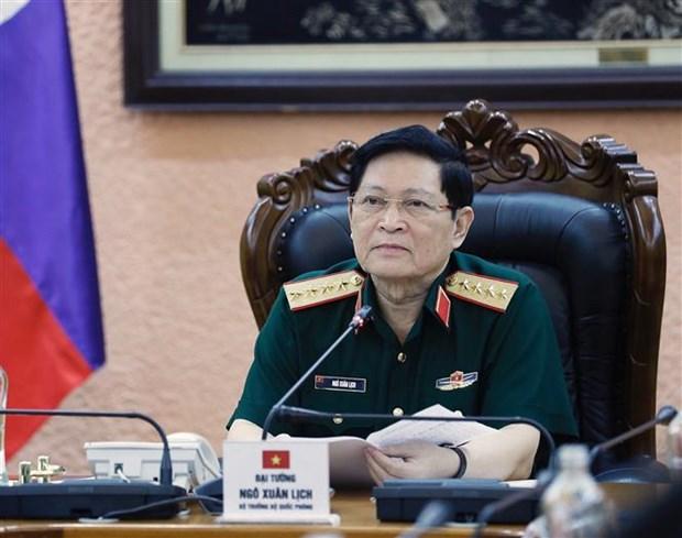越南国防部长吴春历大将与老挝国防部长占沙蒙•占雅拉大将通电话 hinh anh 2