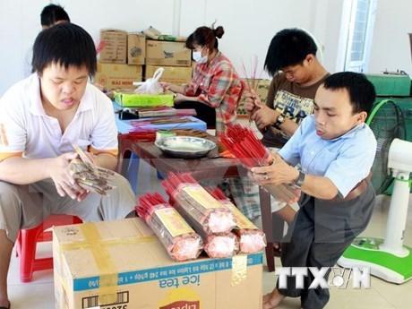 金瓯省积极落实国家对橙剂受害者的优抚政策 hinh anh 1