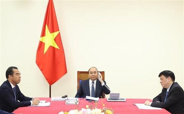 越南政府总理阮春福与德国总理安格拉·默克尔通电话 hinh anh 1
