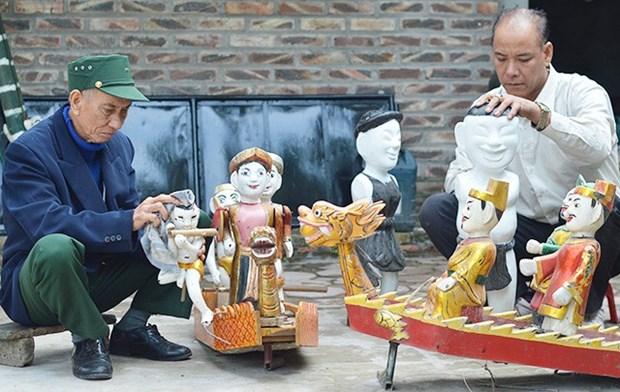 北宁省顺成县的独特的同鱼村水上木偶戏 hinh anh 2