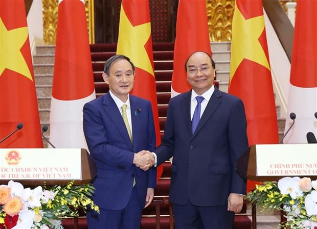 日本与越南保持密切沟通合作 共同抗击新冠肺炎疫情 hinh anh 1