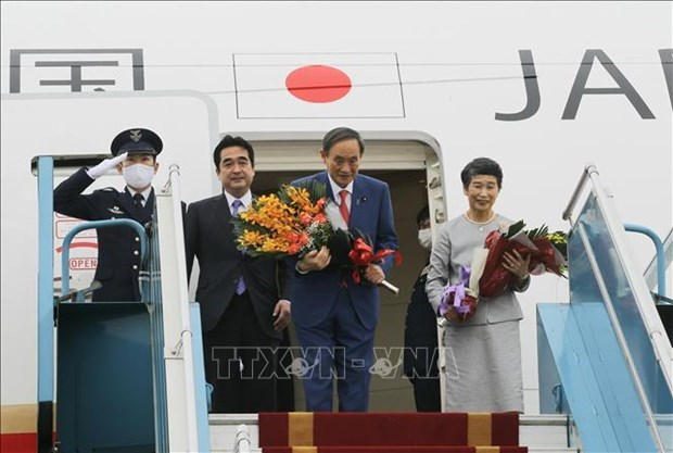 日本首相菅义伟圆满结束对越南的正式访问 hinh anh 1