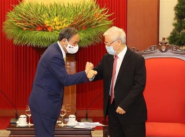 越共中央总书记、国家主席阮富仲会见日本首相菅义伟 hinh anh 2