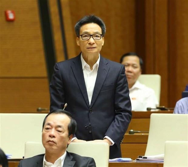 越南第十四届国会第十次会议:武德儋副总理呼吁民众与新冠肺炎疫情安全共处 hinh anh 1