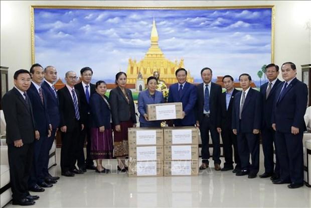 越南与老挝携手抗击新冠肺炎疫情 hinh anh 1